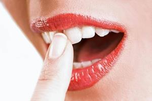 Шатается зуб