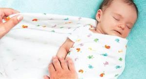 Пеленание младенца во сне