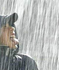 Парень под дождем