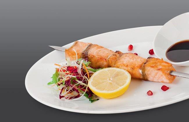 сонник мужчина готовит рыбу