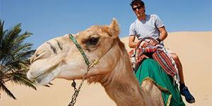 Ехать на верблюде